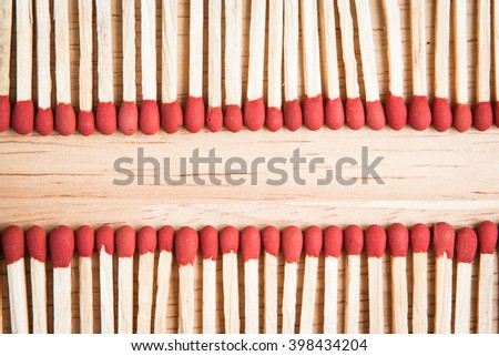 pile of match arrange in a row on a wood background. - stock photo