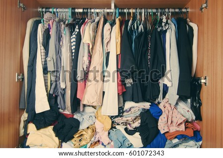 Pile Of Messy Clothes In Closet Untidy Cluttered Woman Wardrobe