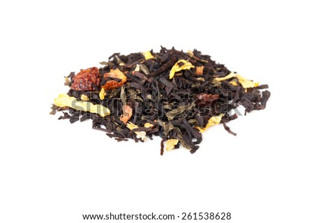 Pile of mixed black and green tea with dry rosehip berries, calendula, sunflower petals  isolated on white background, selective focus with shallow DOF - stock photo