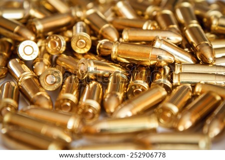 Pile of 9mm ammunition. - stock photo