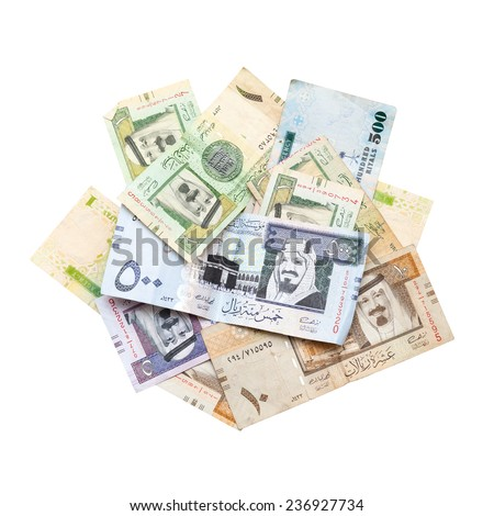 Pile of modern Saudi Arabia money, banknotes isolated on white background close-up photo - stock photo