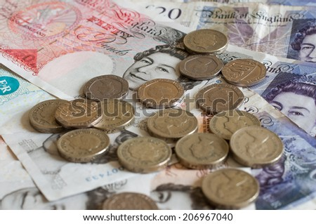 Pile of money and stacked coins british pounds sterling gbp for business and finance - stock photo
