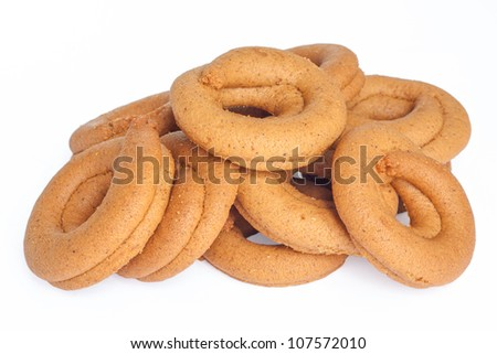Pile of moustokouloura, Greek grape juice biscuits, on a white background. - stock photo