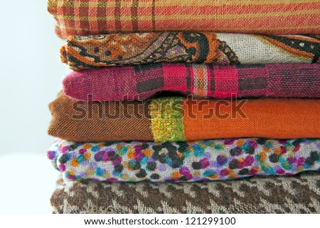 Pile of multi-colored scarfs on a shop counter