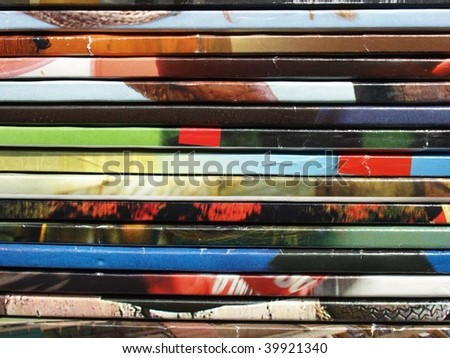 Pile of multicoloured reviews magazines - stock photo