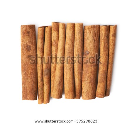 Pile of multiple cinnamon sticks isolated over the white background
