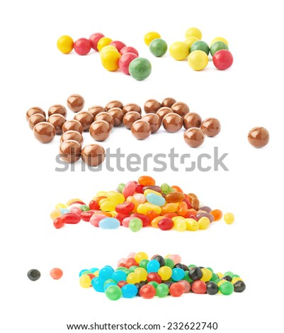 Pile of multiple colorful jelly bean candy sweets isolated over the white background, set of four different kinds of candies - stock photo