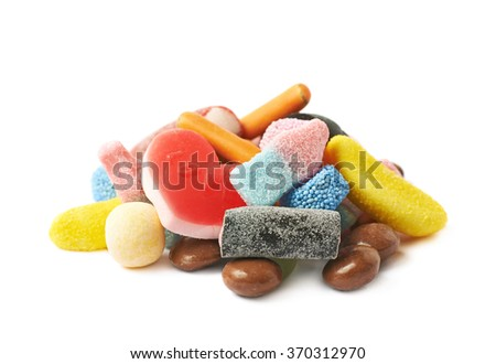 Pile of multiple different candies isolated - stock photo