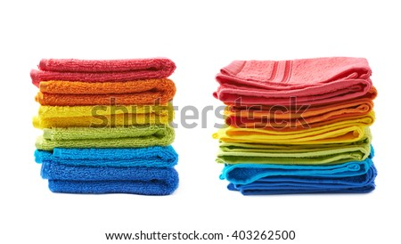 Pile of multiple rainbow colored towels isolated over the white background, set collection of two different foreshortenings - stock photo