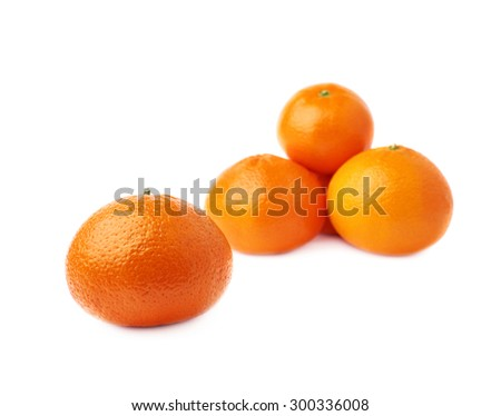 Pile of multiple ripe fresh juicy tangerines, composition isolated over the white background - stock photo