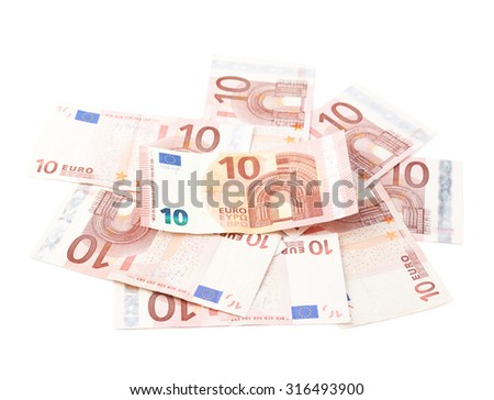 Pile of multiple ten euro bank note bills, composition isolated over the white background