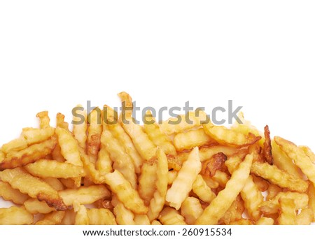 Pile of multiple wavy french fries isolated over the white as a copyspace background composition