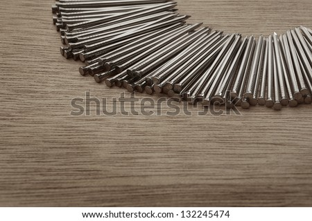 pile of nails shot on a wooden background