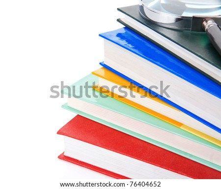 pile of new books and magnifying glass isolated on white background - stock photo