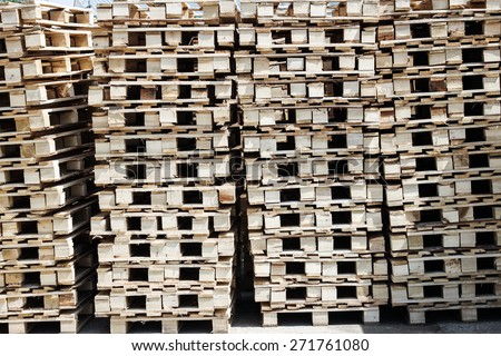 Pile of new pallets sorted and ready for shipping - stock photo