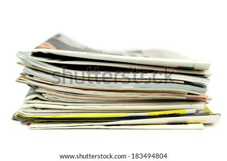 Pile of newspapers and magazines isolated on white background