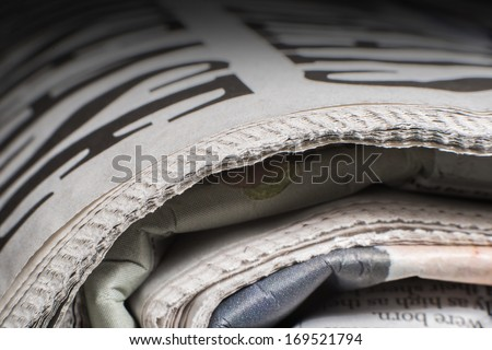 Pile of newspapers close up macro shot - stock photo