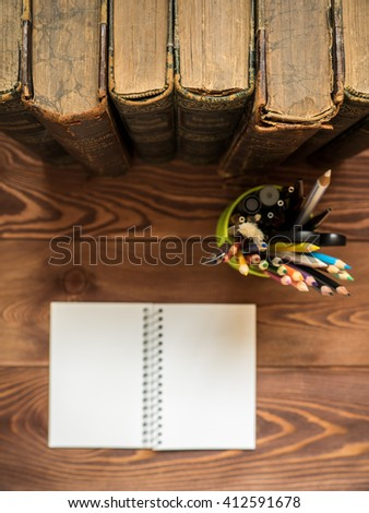 Pile of old antique books on the table. Shallow focus - stock photo