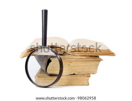 Pile of old books isolated on white - stock photo