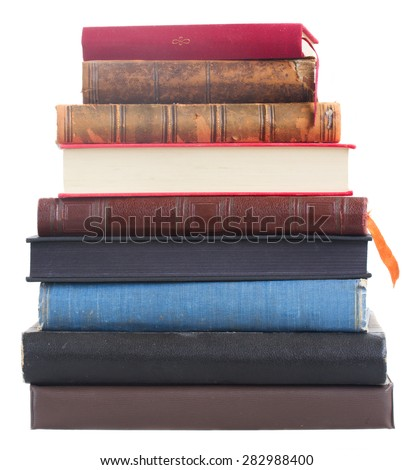 Pile of old books isolated on white background - stock photo