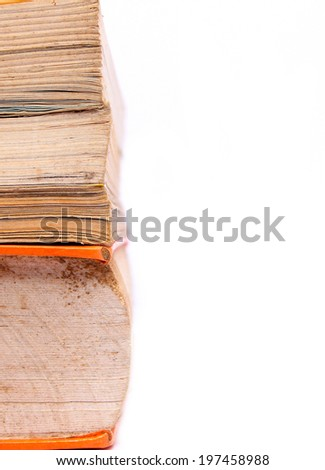 pile of old books on white background - stock photo