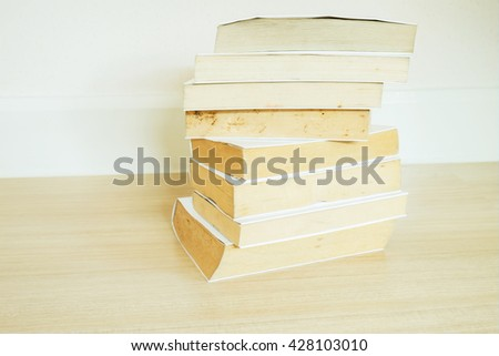 Pile of old books with white cover - stock photo