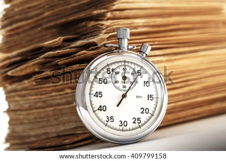 Pile of old cards with stopwatch in closeup - stock photo