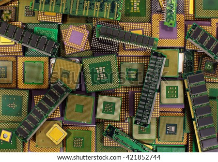 Pile of old CPU chips, obsolete computer processors and memory modules - stock photo