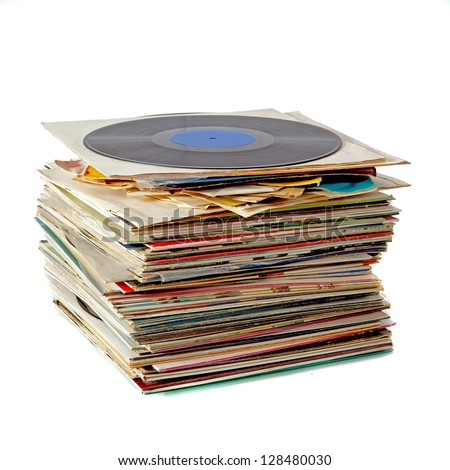 Pile of old dusty vinyl records isolated on white - stock photo