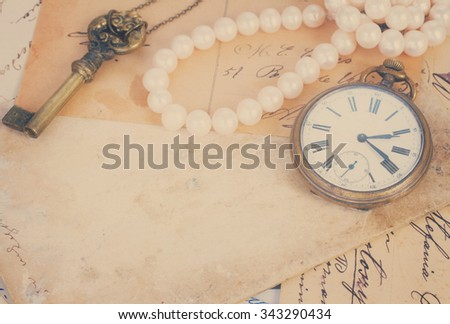 pile of old letters  and antique  clock vintage bckground with copy space, retro toned - stock photo
