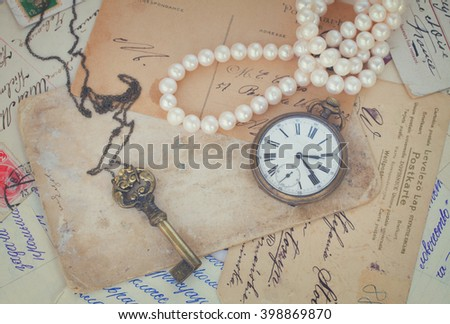 pile of old letters and antiques  vintage background, retro toned - stock photo