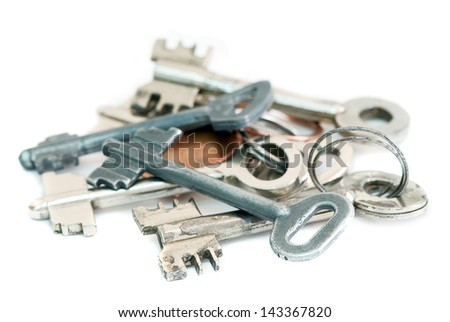 pile of old metal keys on a white background