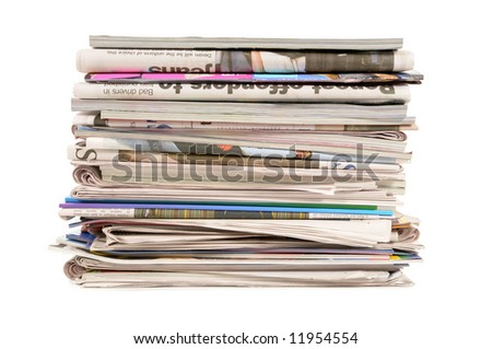 Pile of old newspapers and magazines isolated on white background