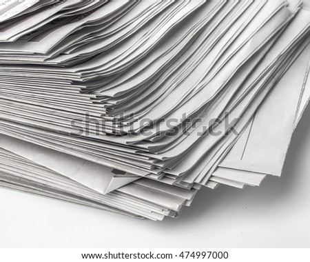 Pile of old newspapers close up background