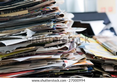 Pile of old newspapers ready for recycling - stock photo