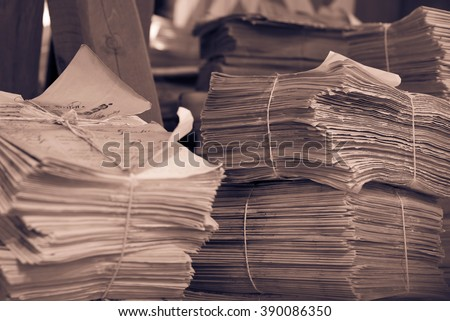 Pile of old newspapers.Selective focus. - stock photo