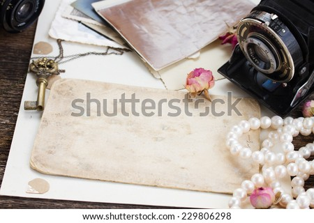 pile of old photos with frame of vintage cameras - stock photo
