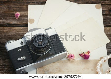 pile of old photos with frame of vintage cameras, retro toned  - stock photo