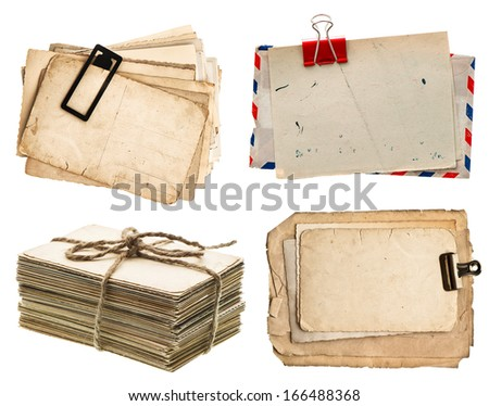 pile of old postcards isolated on white background. vintage paper sheets with clip. air mail envelope. retro design - stock photo