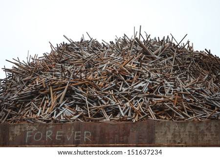 Pile of old rusty industrial metal in a container waiting to be disposed of - stock photo