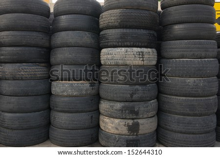 pile of old tires for rubber recycling - stock photo