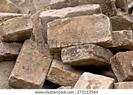 Pile of Old Used Bricks as Building Material on Construction Site.