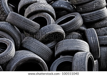 Pile of old used car tires.