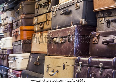 Pile of old vintage bag suitcases - stock photo