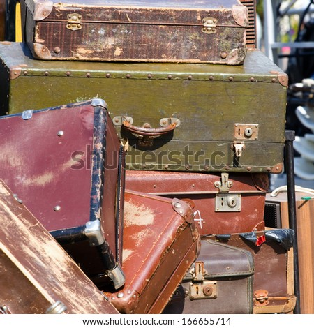 Pile of old vintage suitcases - luggage