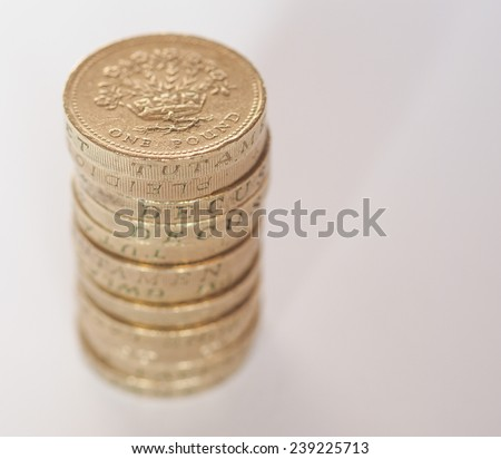 Pile of One Pound coins from UK - with copy space