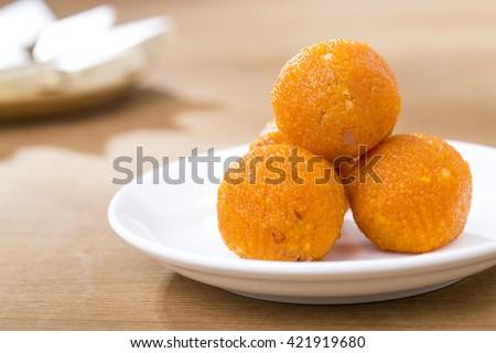 Pile of orange Indian sweets Motichoor Laddu or Laddoo - stock photo