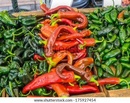 Pile of organic Anaheim peppers for sale at local farmers market. - stock photo