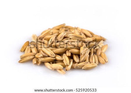 pile of organic oat grains isolated on white background