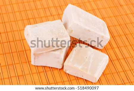Pile of organic soaps on bamboo background.